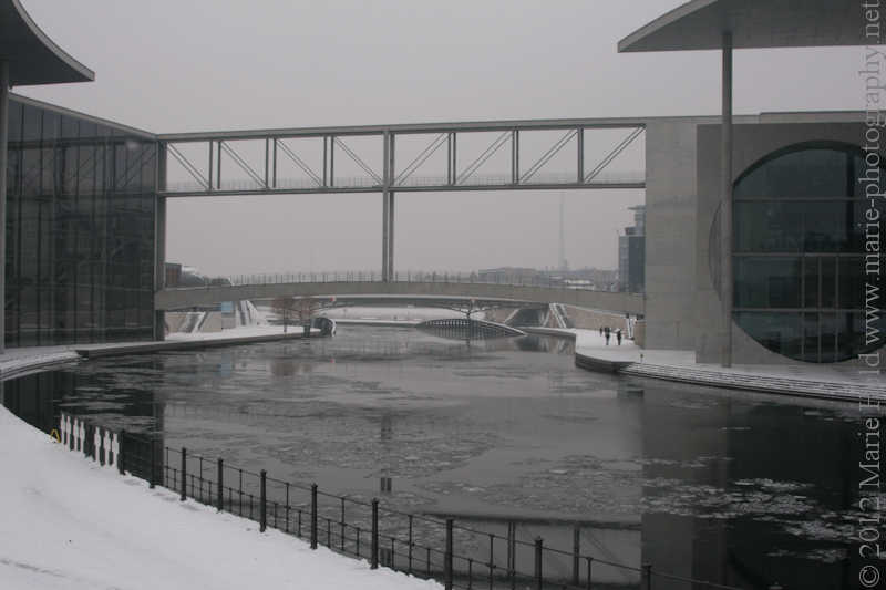 Icy river Spree flowing through the governmental complex.