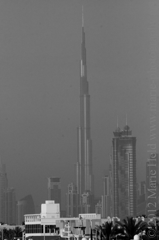 Burj Khalifa seen from Burj al Arab in black and white.