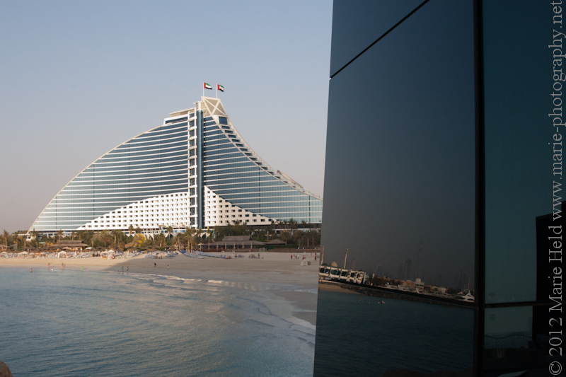 Jumeirah Beach hotel and reflection if Burj Khalifa.